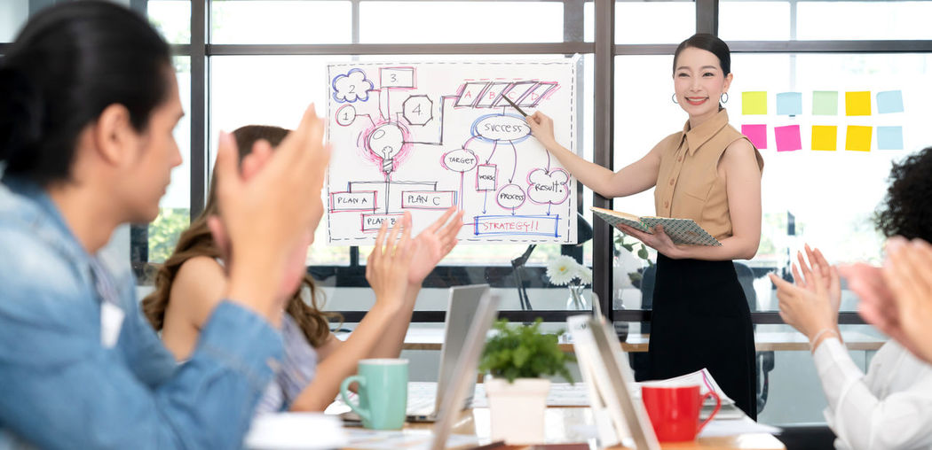 Woman giving presentation at office