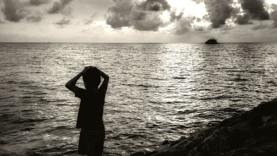 What he is waiting for? This pic was really easy to capture, this small one boy model was standing here without any move for a long long time. So I just took phone a take a pic. I dont know why, but this one is for me one of the best. Sea Water Nature Horizon Over Water Sky Outdoors Scenics Vacations Beach Day One Person Maldives Travelphotography Vacations Traveling Travel Maldives Islands Maldivesphotography Maafushi Boy B&W Portrait Black & White B&w