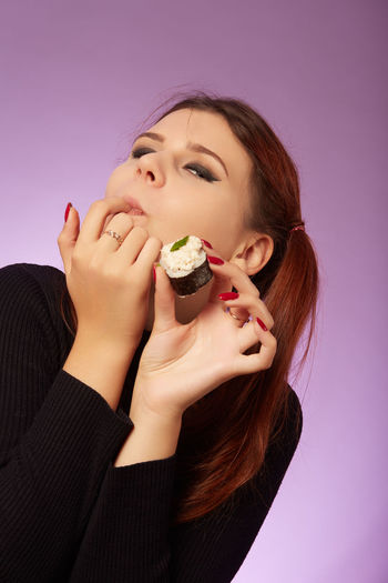 Portrait of a woman eating food