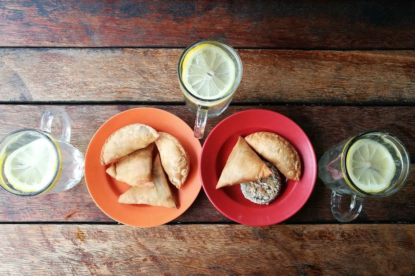 A Malaysian kind of snacks. @onn's Kitchen Johor Bahru Food Plate Wood - Material Citrus Fruit Drinking Glass Drink Refreshment Lemon SLICE Fruit Directly Above Indoors  No People Table Food And Drink