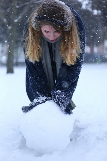 Young Woman Touching Snowball