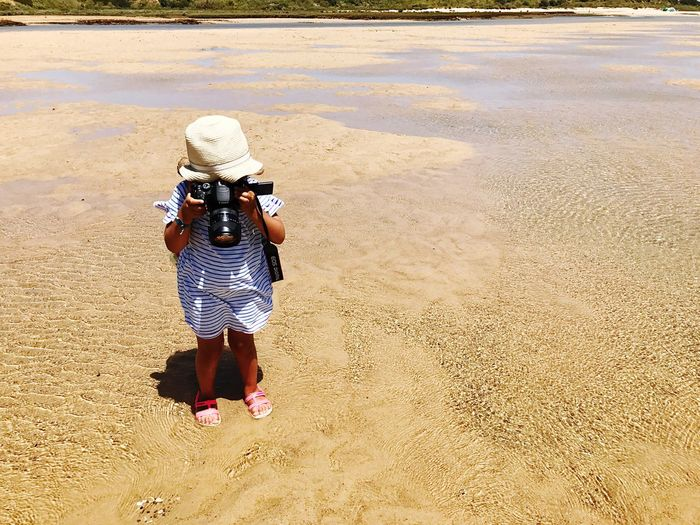 EyeEm Selects Sand Rear View One Person Photography Themes Photographer Full Length Camera - Photographic Equipment Real People Childhood Photographing Beach Standing Outdoors Children Only Child Day People Boys Sand Dune Nature