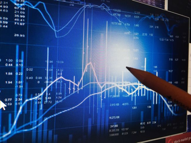 Graph Data Chart Analyzing Finance Financial Figures Stock Market And Exchange Success Investment Number Diagram Technology Business Growth Performance Blue Report Indoors  No People