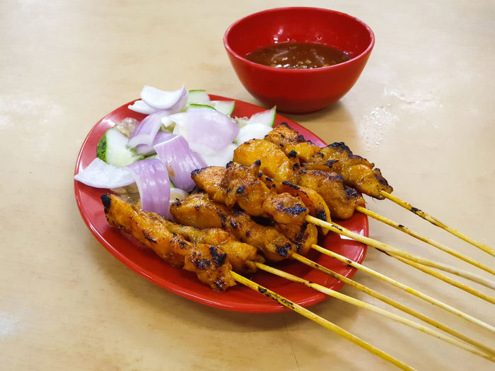 Satay, or sate in Indonesian spelling, is a dish of seasoned, skewered and grilled meat, served with a sauce. It is a dish of Southeast Asia, particularly Indonesia, Malaysia, Singapore and Thailand. Meat Chickens Local Food Lunch Dinner Plate Bowl Food And Drink Close-up Skewer Comfort Food Barbecue Grill Smoked Sauce Grilled Grilled Chicken Barbecue Marinated