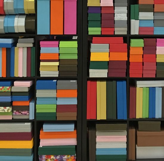 Close-up of stack of books in shelf