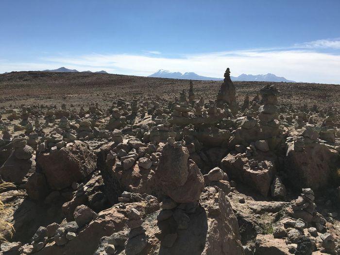 Eroded rocks on landscape against sky