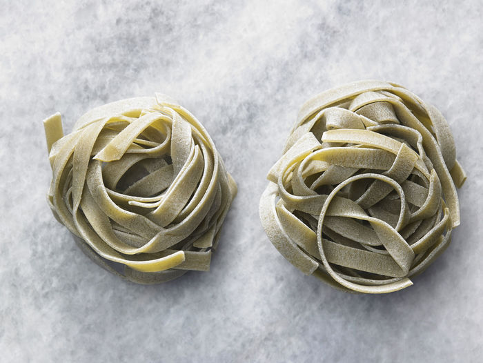 High angle view of tagliatelle pasta on table
