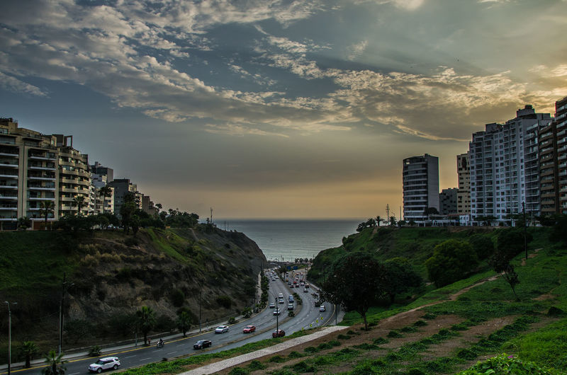 Panoramic View Of Buildings And Sea Against Sky During Sunset