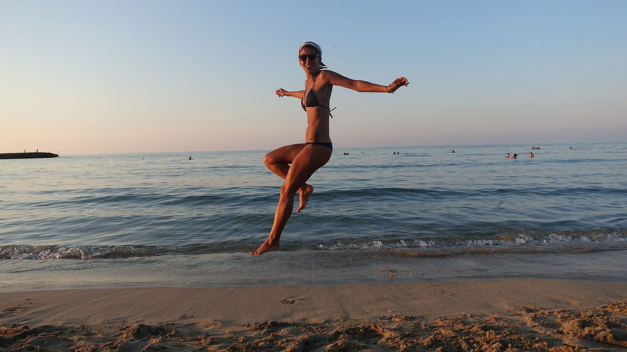 One People Lifstyle Sunset Sea Streetphotography Happy People Beachphotography Beach Women Ostuni Puglia Full Length Motion One Person Water Sport Sky Exercising Healthy Lifestyle Lifestyles Holiday Young Adult Vitality Jumping Vacations Horizon Over Water Adult Land