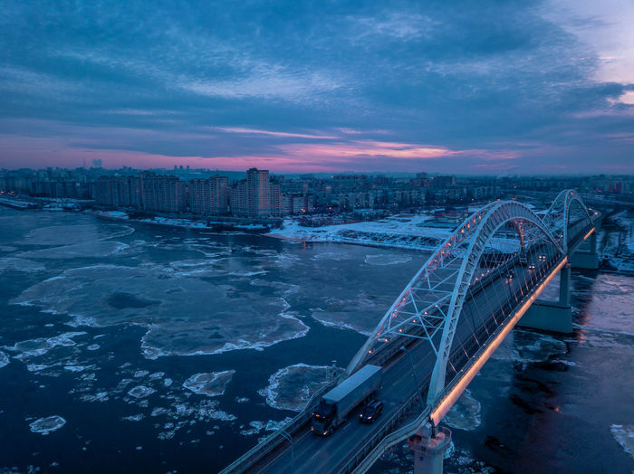 High angle view of bridge in city against sky at sunset