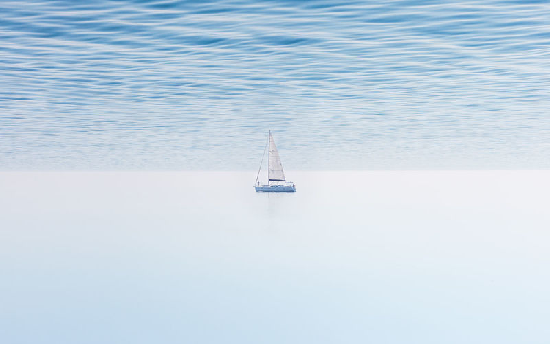 Dreamer Adventure Beauty In Nature Blue Boat Calm Day Fantasy Horizon Over Water Journey Nautical Vessel No People Ocean Outdoors Sailboat Sailing Sea Seascape Serenity Solitude Tranquil Scene Tranquility Water