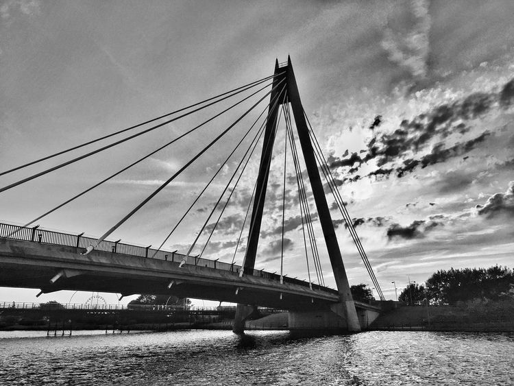 Bridge - Man Made Structure Sky Connection Transportation River Architecture Cloud - Sky Suspension Bridge Built Structure Outdoors Day Water Low Angle View No People Nautical Vessel Tree Nature IPhoneography JoMo Photo Blackandwhite Black And White Liverpool