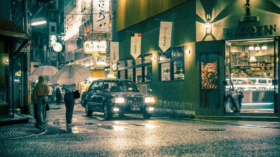 Hiroshima Cinematic Cinematic Photography Japan Japan Photography Nightphotography Architecture Building Exterior Built Structure Car City Hiroshima Illuminated Land Vehicle Mode Of Transport Night Outdoors Real People Street Streetphotography Transportation