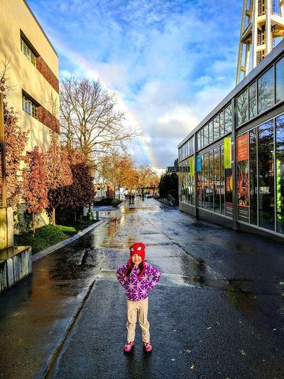 Full length of girl on street against sky in city