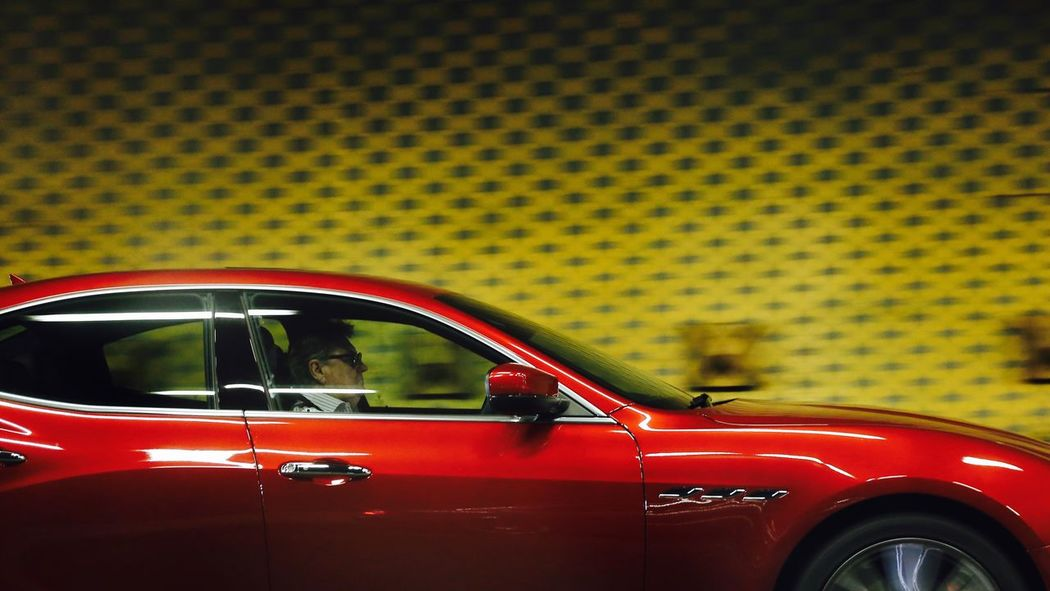 Red (time) goes faster (with age). Car Transportation Land Vehicle Mode Of Transport No People Day Yellow Taxi Outdoors Red Car Sports Car Old Man Driving One Person Yellow Background Real People Car Window Motion Effect Adult
