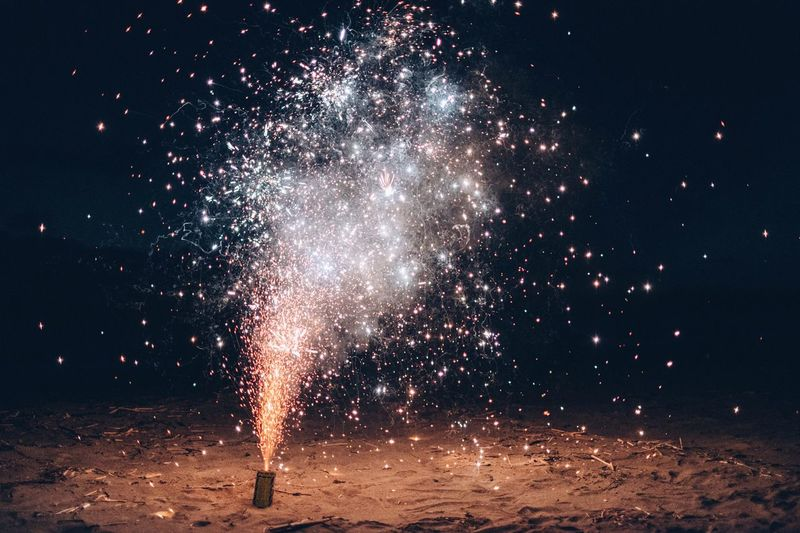 Burning Firework At Beach During Night