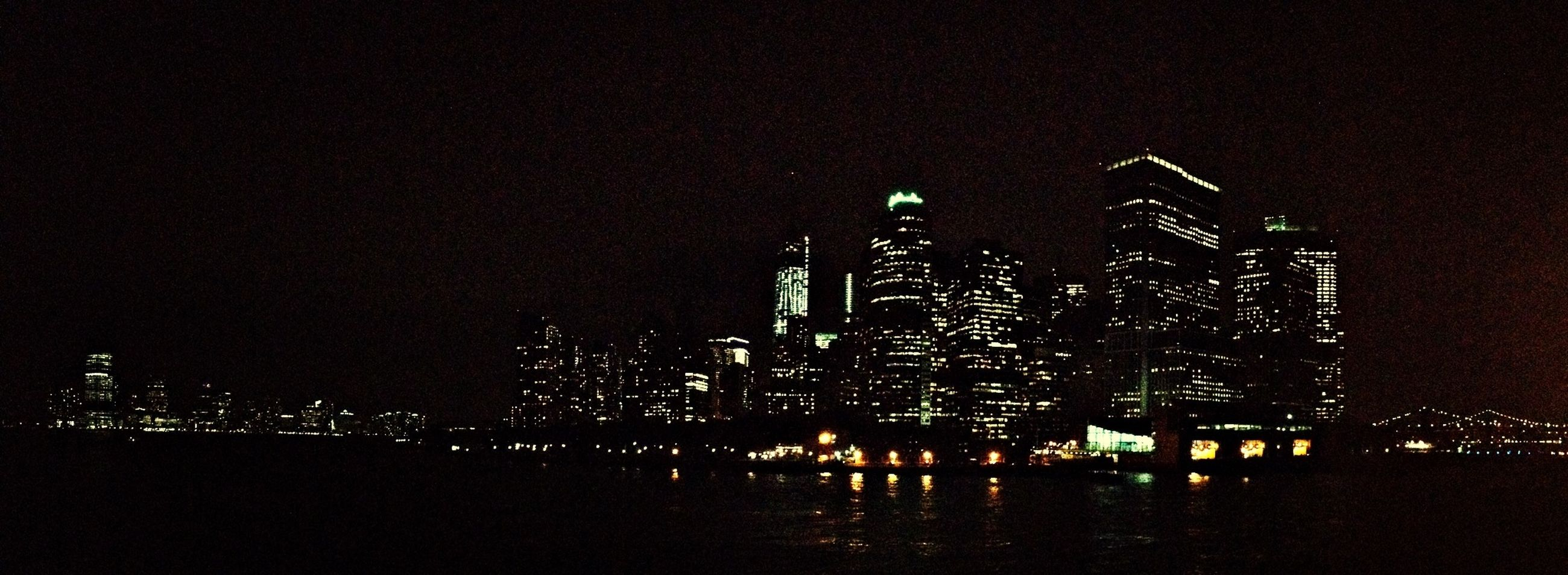 night, illuminated, architecture, built structure, building exterior, city, cityscape, skyscraper, water, modern, sky, reflection, river, tall - high, urban skyline, clear sky, tower, waterfront, office building, copy space