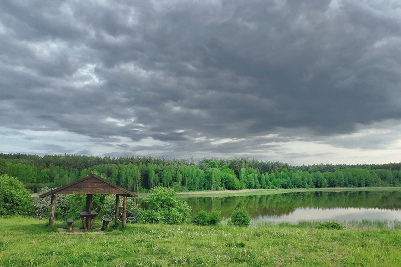 Nature Cloud - Sky Green Color Tree Landscape Rural Scene No People Outdoors Sky Beauty In Nature Scenics Agriculture Storm Cloud Storm Day Kielary Poland Lake Jezioro The Week On EyeEm