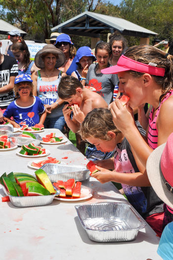 Kids watermelon eating challenge at the Coogee Beach Festival in Coogee, Western Australia. Child Childhood Competition Competitive Eating Contest Coogee Coogee Beach Festival Crowd Day Eating Eating Event Family Festival Food Food And Drink Fruit Fun Medium Group Of People Outdoors People Speed Togetherness Watermelon Western Australia