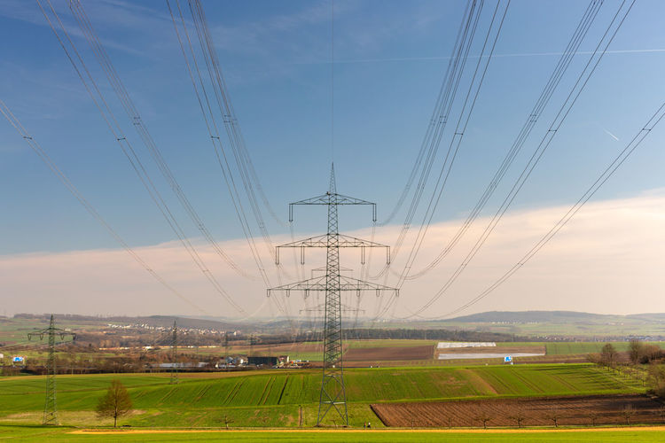 Sky Electricity  Cable Electricity Pylon Technology Power Supply Power Line  Field Fuel And Power Generation Connection Landscape Land Nature Environment No People Rural Scene Day Cloud - Sky Agriculture Outdoors