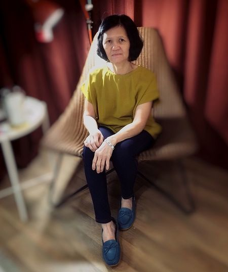 Full Length One Person Sitting Looking At Camera Portrait Casual Clothing International Women's Day 2019 Indoors  Leisure Activity Front View Women Seat Lifestyles Real People Adult Contemplation