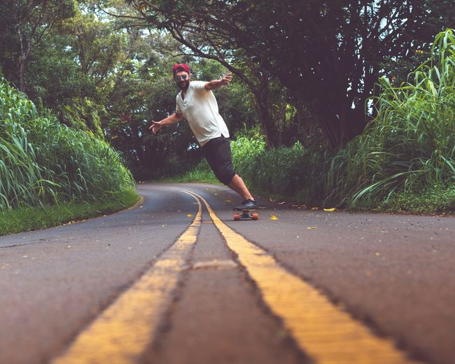 Road Forest Island Nā Pali Coast State Park Adventure Travel Summer Hawaii Man Tree Full Length Motion Happiness Fun Jumping Enjoyment Childhood Energetic Longboard Skating Skateboard Skating Summer Road Tripping The Traveler - 2018 EyeEm Awards