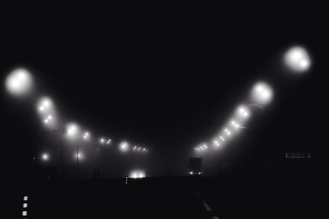 ILLUMINATED LIGHTS AGAINST SKY
