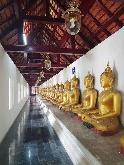 Illuminated statues in building
