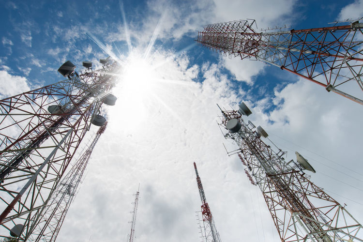 Antenna tower, low angle view. 4g Coverage Low Angle View Microwave Tower Repeater Antenna Sunrays Cellular Tower Clouds And Sky Height Radio Antennas Sunbeam TelecommunicationTower Telecommunications Equipment Television Tower Wireless Communication
