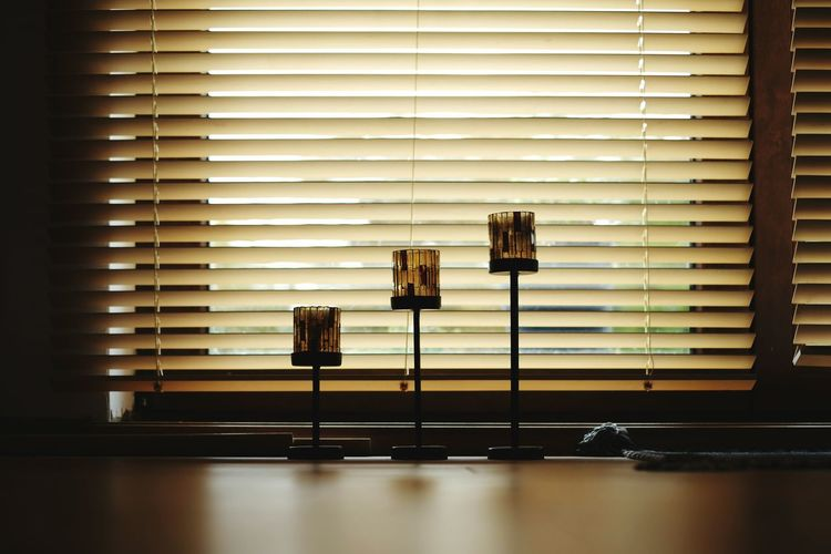 Lamps against blinds window at home
