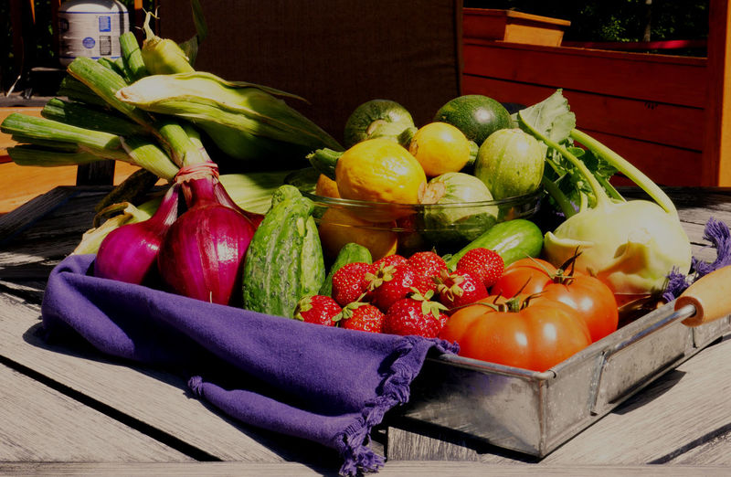 Fruits and vegetables in crate at market stall
