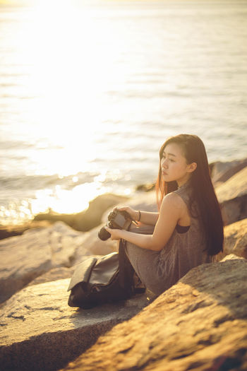 Beach Casual Clothing Day Focus On Foreground Leisure Activity Lifestyles Nature Outdoors Person Portrait Portrait Of A Woman Portrait Photography Portraits Relaxation Shore Sitting Sunest Sunlight Tranquility Vacations 43 Golden Moments