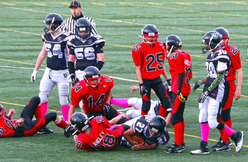 Junior Football in Minoru Park. Richmond B.C. Canada. Sport Sports Uniform Males  Sports Clothing Outdoors People Red Flexibility Sportsman Sports Team Richmond BC Uniform Canada B.C Minoru Park Junior Football Teamwork Team Sport Sports Helmet Headwear Competition
