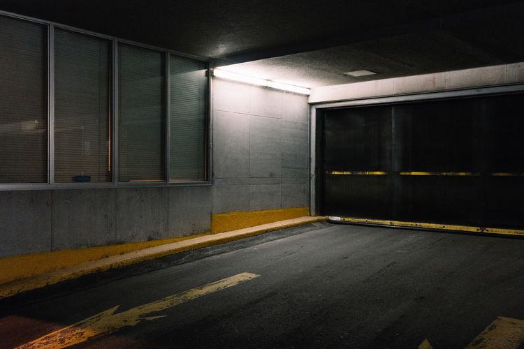 Empty road in illuminated building