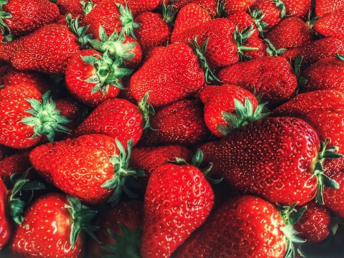 High angle view of strawberries at market stall