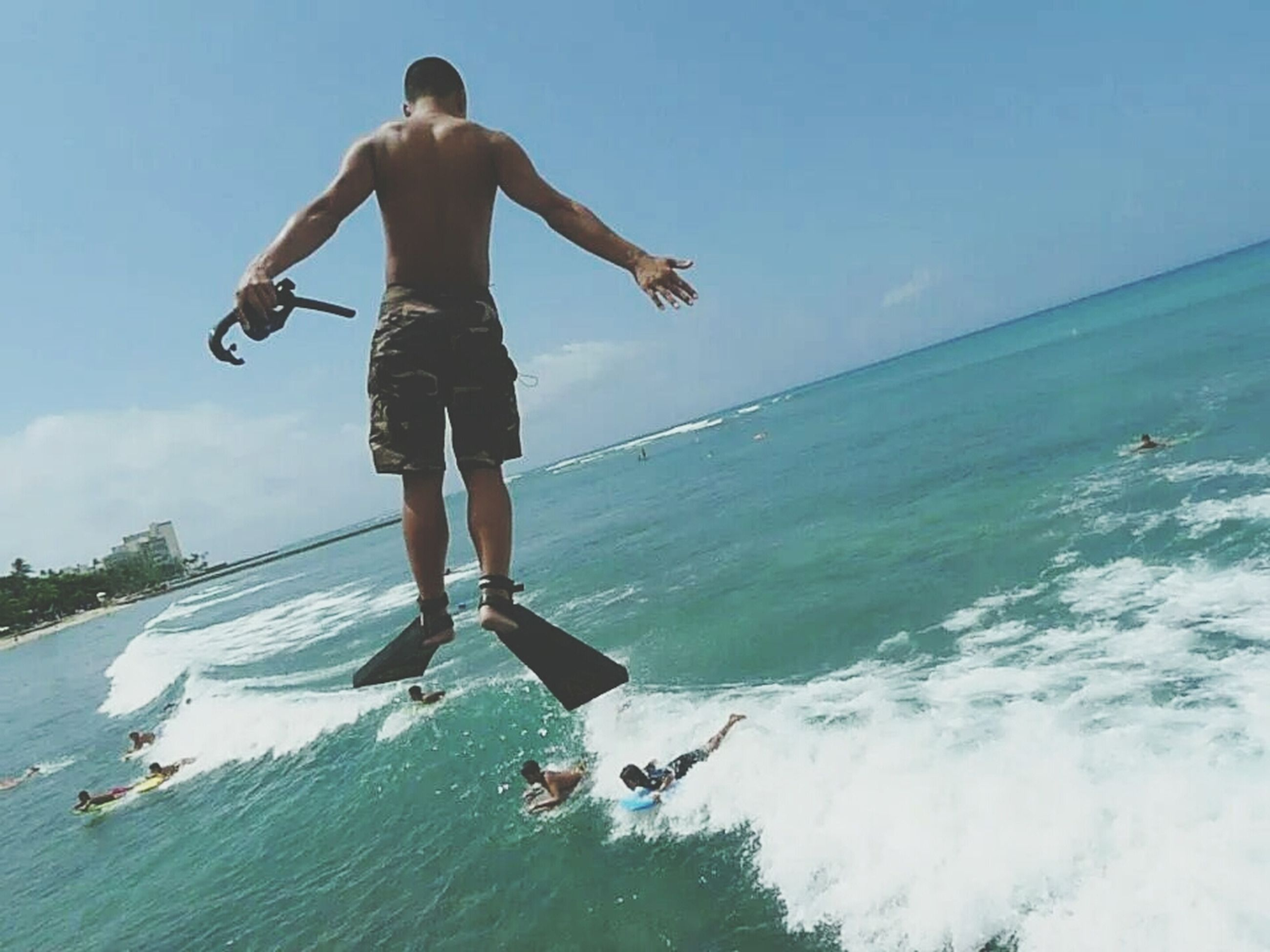 sea, water, lifestyles, leisure activity, full length, enjoyment, horizon over water, mid-air, fun, sky, vacations, jumping, wave, motion, extreme sports, men, beach, sport