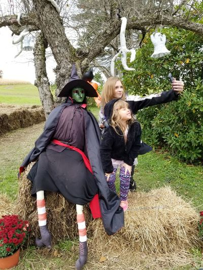 young people taking a selfie Tree Young Women Witch Farmland Halloween