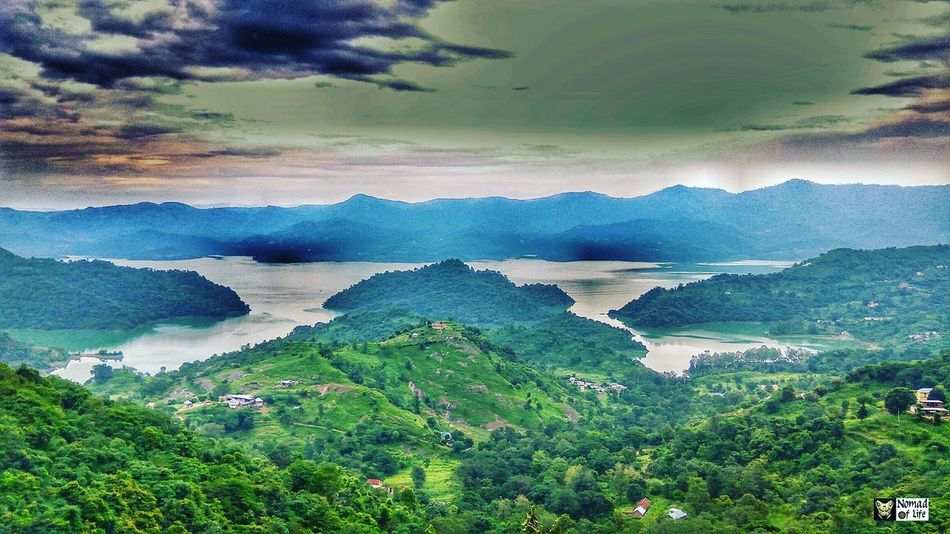 Straight out of dystopian future 😍🇮🇳 Water Nature Beauty In Nature Landscape Lake Scenics Outdoors Cloud - Sky No People Beach Beauty Sky Day Wanderlust Rainy Days☔ Travelgrams High Angle View Nomad EyeEm Motorcycle Photography Highwayphotography Tree Beauty In Nature NOMAD Eyeemphotography Photography
