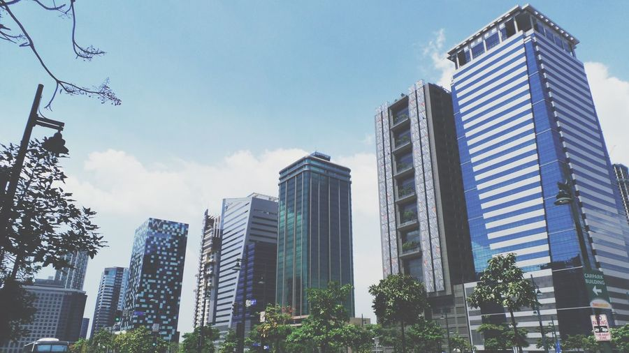 Global City #bgc #globalcity #manila #philippines Architecture Building Building Exterior Built Structure City Day Financial District  Low Angle View Modern Nature No People Office Office Building Exterior Outdoors Plant Sky Skyscraper Sunlight Tall - High Tower Tree First Eyeem Photo