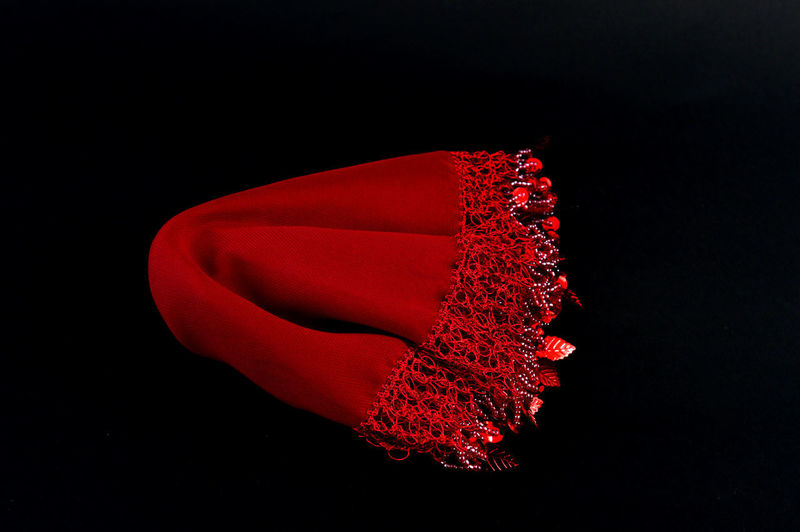 handmade handkerchief used for dancing on a turkish wedding on black background Art And Craft Artisan Black Background Celebration Dance Red Tradition Turkey Wedding Balkans Black Background Bride Ceremony Close-up Elegance Beauty Embroidery Handicraft Handkerchief Handmade Heritage Leaf No People Still Life Studio Shot Traditional