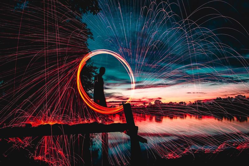 Steel wool Red Hot Light Steelwool Illuminated Motion Night Nature No People Water Long Exposure Sky Outdoors Glowing Geometric Shape Speed Shape Architecture Circle Built Structure Pattern Arts Culture And Entertainment Wet