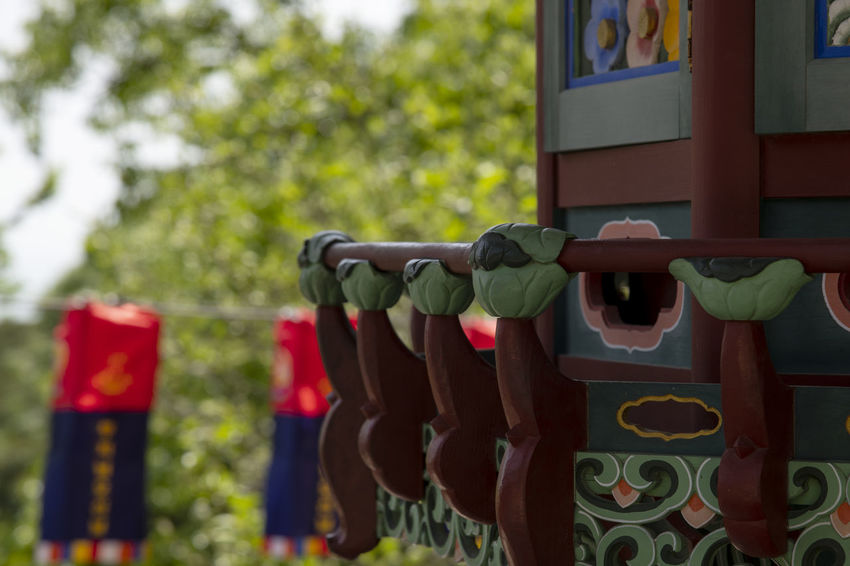 view of Bomunsa, a famous Buddhism temple in Seokmodo, Kimpo, Gyeonggido, South Korea Bomunsa Buddhism Temple Seokmodo Buddhism Close-up Clothing Day Focus On Foreground Ganghwado Green Color Hanging In A Row Metal Multi Colored Nature No People Outdoors Plant Protection Red Safety Security Selective Focus Side By Side Temple Tree