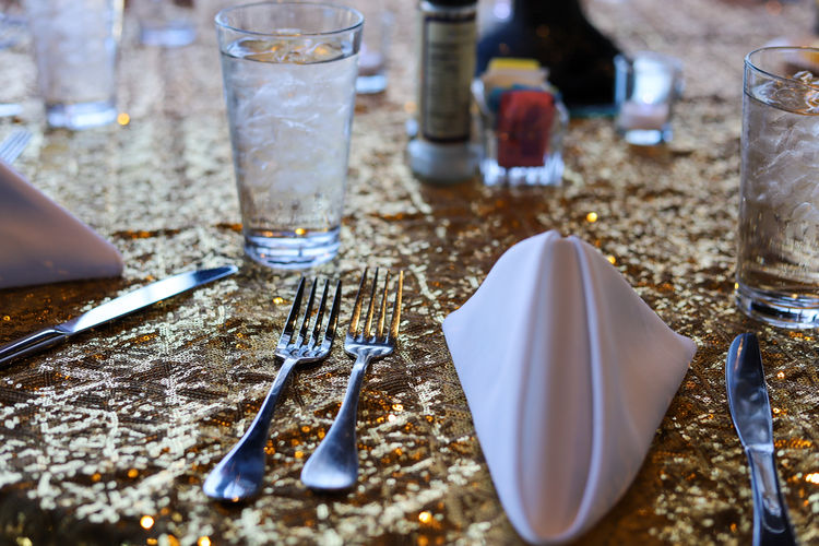 High angle view of  fork and napkin  on table