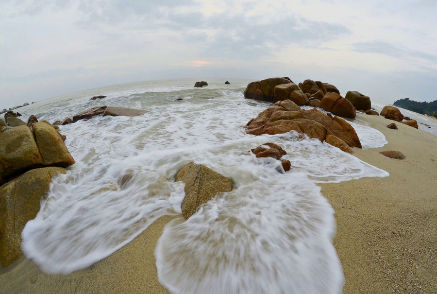 beach Fish Eye Lens Beach Sea Rock - Object Outdoors No People Nature Day Sand Water Beauty In Nature Landscape Wave Sky