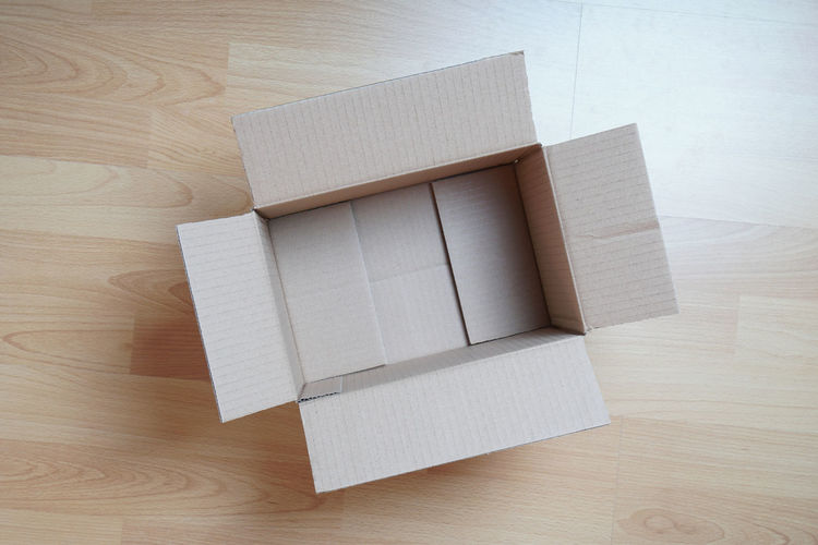 Indoors  High Angle View No People Hardwood Floor Container Box Box - Container Empty Cardboard Box Packaging Floor Laminate Parcel