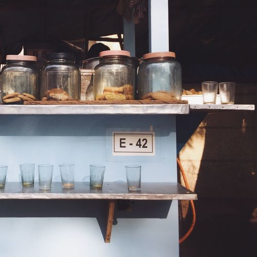 Drinking glasses and jars at tea stall