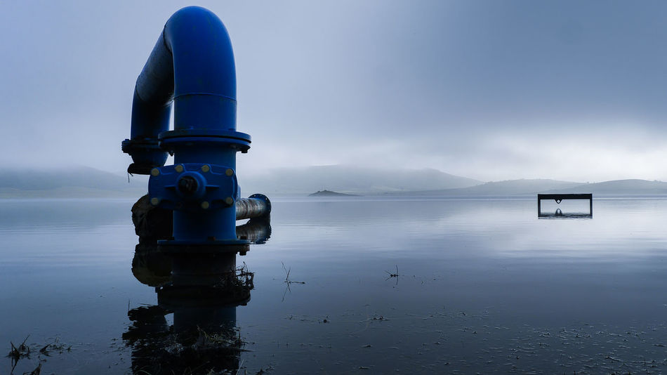 Blue steel pipe - Foggy lake outside Pamplona Beauty In Nature Blue Cloud - Sky Day Environment Horizon Over Water Idyllic Landscape Nature Nautical Vessel No People Outdoors Reflection Scenics Sea Sky Tranquil Scene Tranquility Travel Destinations Water