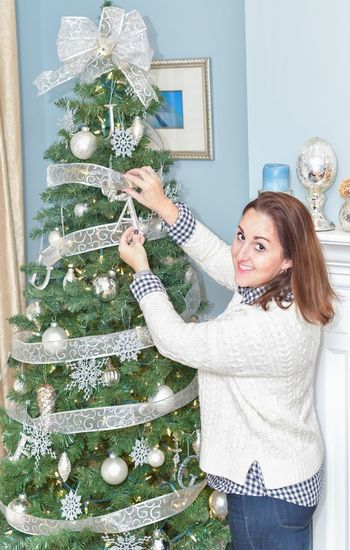 EyeEm Selects Christmas Christmas Decoration Christmas Tree Celebration Decoration Christmas Ornament Silver Colored Indoors  One Person Smiling Holiday - Event Celebration Event Christmas Present One Woman Only Cheerful Women Happiness Tree Gift Home Interior