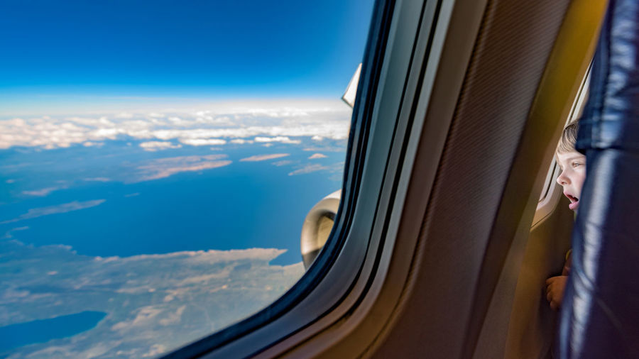 """The wonder of flight and the beauty of our world (Nikon D810 14.0-24.0 mm f/2.8 ƒ/3.5 14.0 mm 1/200"""" iso 64) Aerial View Airplane Amazement Beauty In Nature Kid Travel Airline Child Copy Space Day Earth Flight Flying Journey Landscape Mode Of Transport Our World Out Of An Airplane Window Scenics Sky Transportation Window Flying High Long Goodbye Let's Go. Together."""