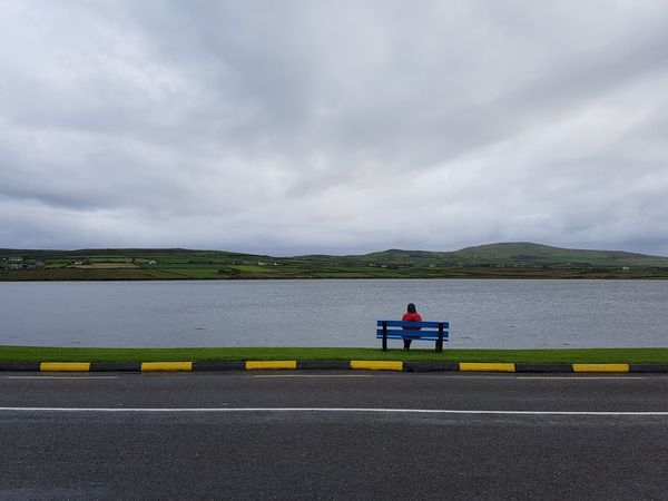 Looking over Valentia island, County Kerry, Ireland. Travel Water Road Full Length Reflective Clothing Sky Overcast Weather Tranquil Scene Tranquility Scenics Remote Calm Sky Only Countryside